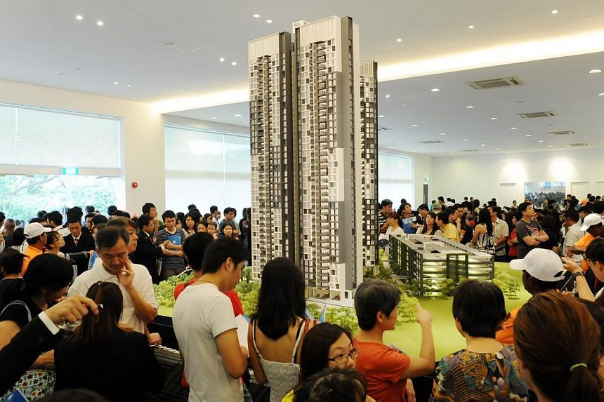 Crowds looking at the architectural model Trivelis condominium at the showroom in Clementi Avenue 4 on Sept 6, 2013. The growth in prices of Singapore's private homes moderated in the third quarter of this year, rising by 0.4 per cent from the second