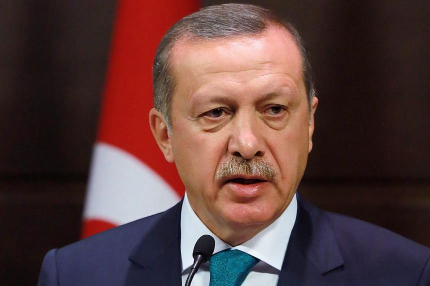 Turkish Prime Minister Recep Tayyip Erdogan speaks during a news conference in Ankara, Turkey, Monday, Sept 30, 2013. Turkey on Monday announced it would lift a ban on women wearing headscarves in most public offices, following other measures critics