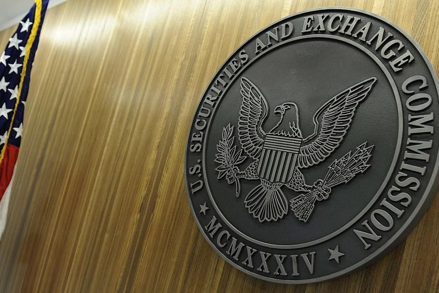 The seal of the U.S. Securities and Exchange Commission (SEC) hangs on the wall at their headquarters in Washington, in this June 24, 2011 file photo. The United States (US) Securities and Exchange Commission (SEC) would continue reviewing initi