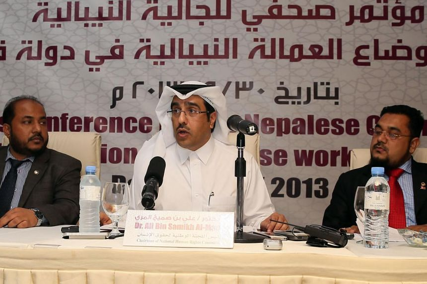 Macksud Alam, head of the Nepalese Community in Qatar (Left), Qatari Ali bin Sumikh al-Marri, Chairman of the National Commission for Human Rights (Centre) and Mohammed Ramazan Ali, legal advisor for Nepali nationals in Qatar, attend a press conferen