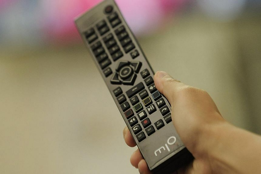 """MIO tv remote control.The Media Development Authority (MDA) forced SingTel to share its English Premier League (EPL) broadcasts because the telco had made it """"commercially unviable"""" for rival StarHub to purchase the rights. -- ST FILE PHOTO:&nb"""