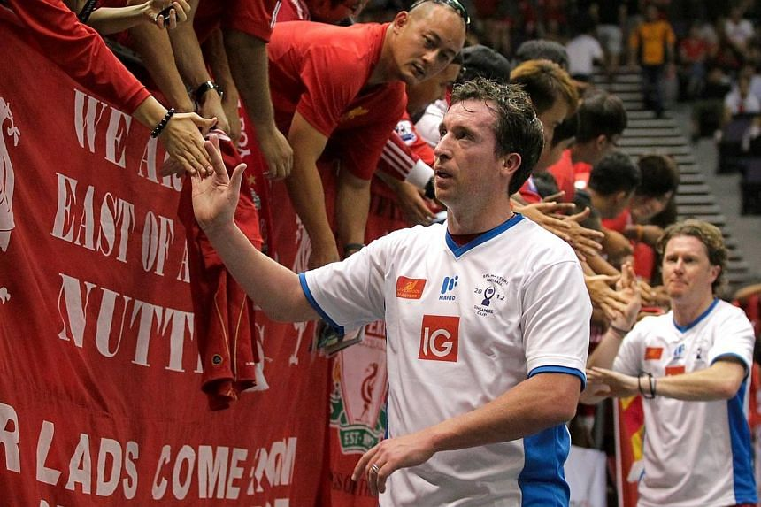 Former Liverpool legends Robbie Fowler (left) and Steve McManaman at the EPL Masters Singapore Cup at the Singapore Indoor Stadium on Oct 14, 2012.Fowler, McManaman and Rob Jones are now helping manager Brendan Rodgers develop the next generati