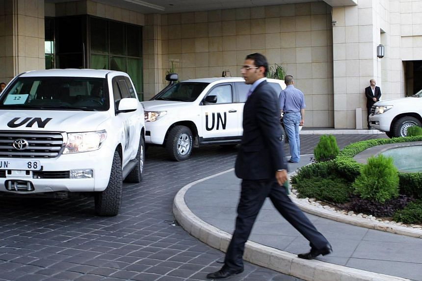 United Nations vehicles are seen as a chemical weapons disarmament team arrived in Damascus on Tuesday, Oct 1, 2013.International disarmament experts were to begin cataloguing Syria's vast arsenal of chemical weapons on Wednesday, checking a li