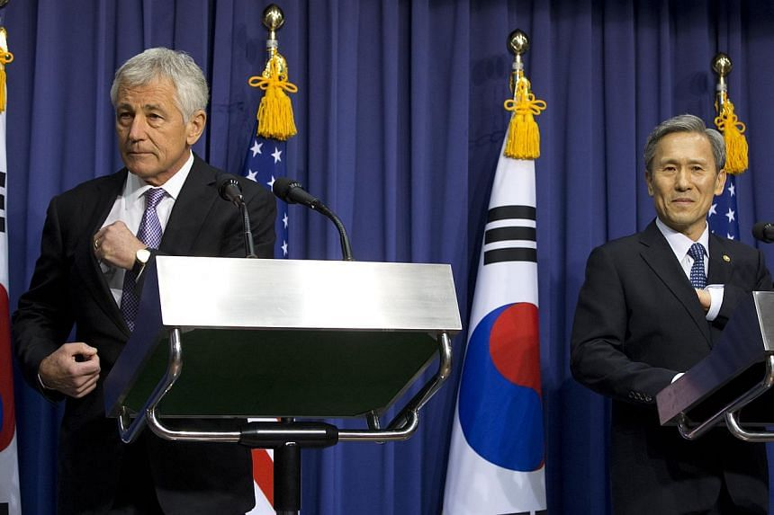 U.S. Secretary of Defense Chuck Hagel, left, and South Korean Defense Minister Kim Kwan-jin, arrive for a news conference at the Ministry of National Defense in Seoul, South Korea, on Wednesday Oct 2, 2013. South Korea and the United States signed a