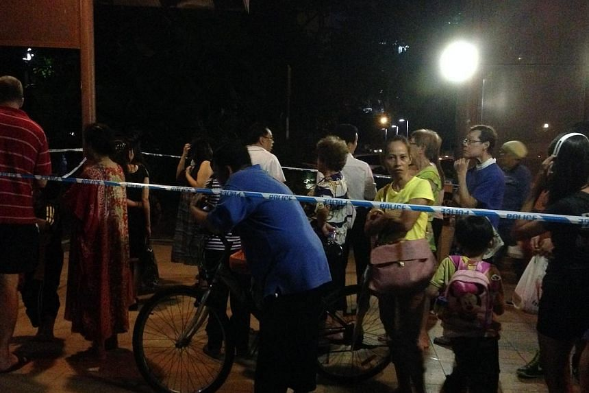Residents waiting for the police cordon to be lifted.-- ST PHOTO: MUGILAN RAJASEGERAN