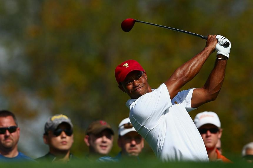 Tiger Woods of the United States (US) team hits a shot during a practice round prior to the start of The Presidents Cup at the Muirfield Village Golf Club on Oct 1, 2013 in Dublin, Ohio. Woods has found camaraderie on the US Presidents Cup squad, the
