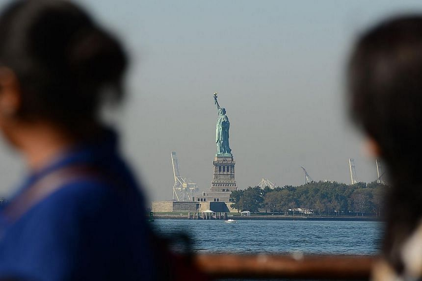 The Statue of Liberty stands empty of visitors after it closed due to an US government shutdown in New York, Oct 1, 2013. -- PHOTO: AFP