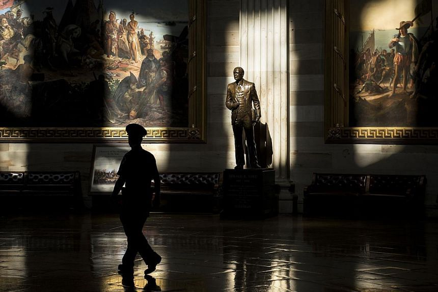 A US Capitol Police officer walks through the Rotunda of the US Capitol while the building was closed to tours on Oct 1, 2013 in Washington. -- PHOTO: AFP