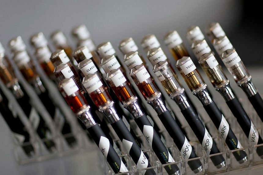 Electronic cigarettes with different flavoured e-liquid are seen on display at the Vapor Shark store in Miami, Florida, on Sept 6, 2013. E-cigarette manufacturers have seen a surge in popularity for the battery-powered devices that give users a vapou