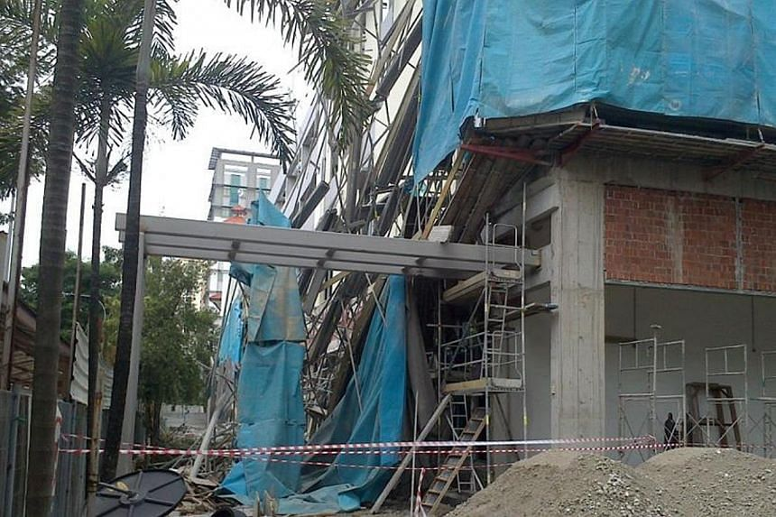 Seven workers were injured at a construction site along Braddell Road on Wednesday morning in the second worksite accident this week. -- PHOTO: MOHAMMED AFDHAL