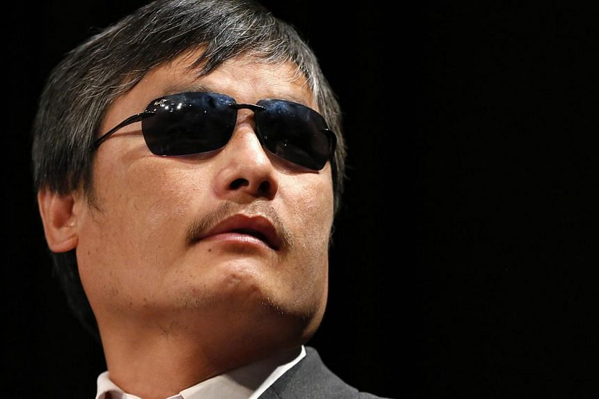 Chinese dissident Chen Guangcheng speaks to journalists following an appearance in New York on May 3, 2013. Mr Chen, the Chinese activist who dramatically fled house arrest, will join three organisations including a conservative institute after falli