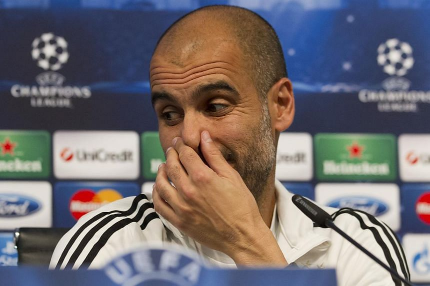 Bayern Munich's head coach Pep Guardiola gestures, during a press conference at the Etihad Stadium, Manchester, England, Tuesday Oct 1, 2013. Bayern Munich will play Manchester City on Wednesday in a Champions League Group D soccer match. Guardiola b