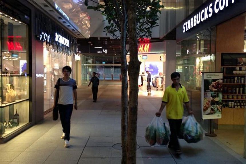 Tenants at Jem mall were eager to get back to business even before the official opening time at 10am on Wednesday morning.-- ST PHOTO: ALPHONSUS CHERN