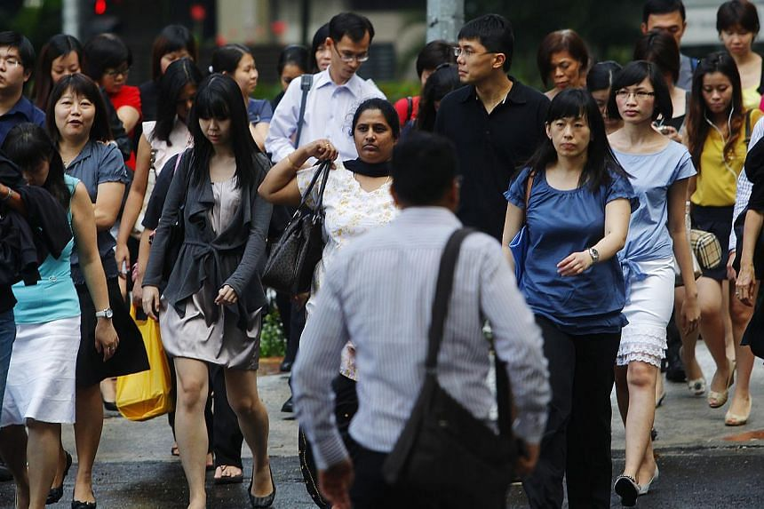 Office workers walking in Tanjong Pagar. A new index that measures a country's ability to make the most of its workers has ranked Singapore as the third most successful in the world and the best in Asia. -- ST FILE PHOTO: TED CHEN