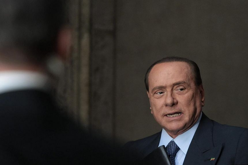Italy's former prime minister Silvio Berlusconi arrives at the lower house of parliament in Rome, Sept 30, 2013. Italy's Silvio Berlusconi on Tuesday pressed ahead with plans to topple Prime Minister Enrico Letta but looked increasingly isolated as t