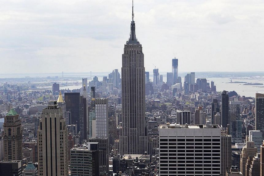 The Empire State Building is seen from the top of The Rock in New York in this April 25, 2012 file photo. New York City's iconic Empire State Building went public Wednesday as part of a real estate trust traded for the first time on the New York Stoc