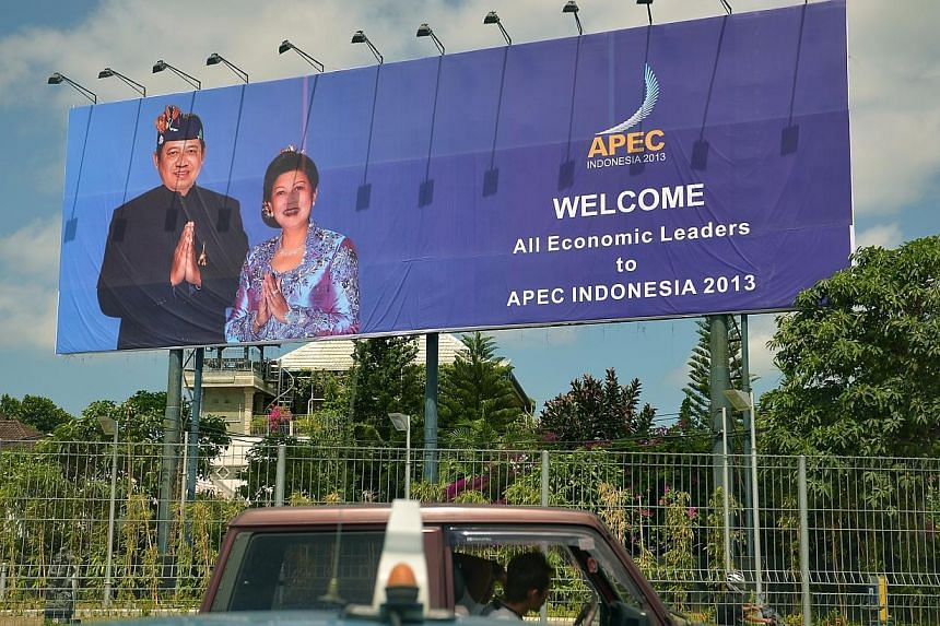 APEC billboards in Nusa Dua, Bali.Russian President Vladimir Putin and United States President Barack Obama may discuss the Syria crisis on the sidelines of an Asia-Pacific summit next week in Bali, a Kremlin aide said on Thursday. -- ST PHOTO: