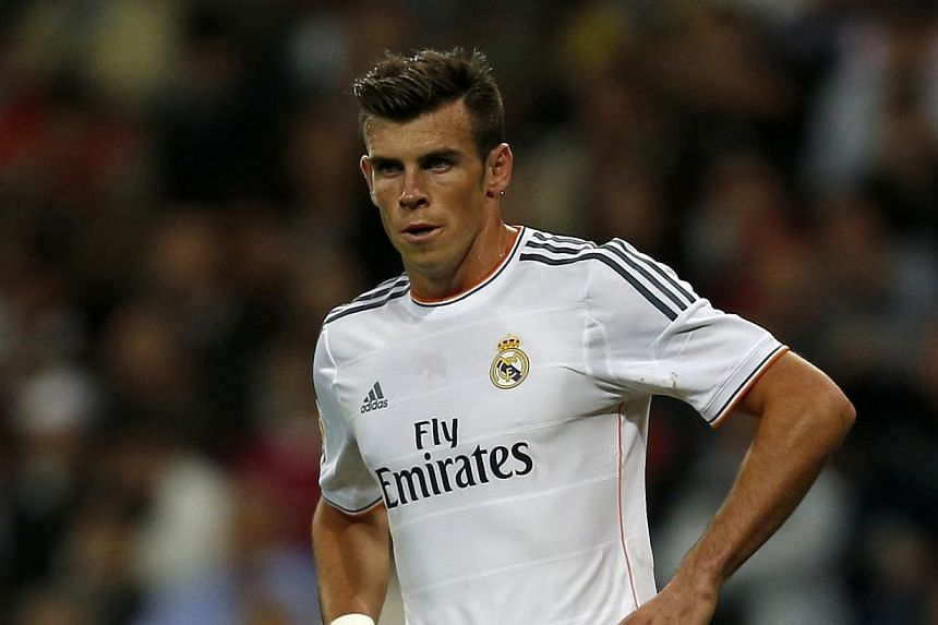 Real Madrid's Gareth Bale is seen during the Spanish first division soccer match against Atletico Madrid at Santiago Bernabeu stadium in Madrid on Sept 28, 2013.Bale will not feature for Wales in their final two World Cup qualifiers, manager Ch