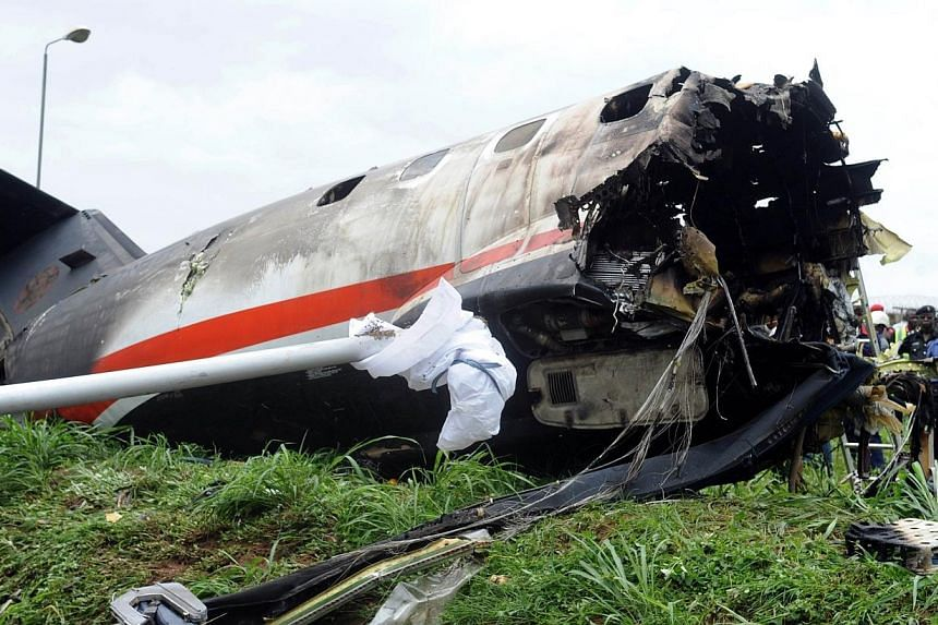 The wreckage of an Associated Airlines plane that crash-landed at Sahara Airport shortly after take-off at Lagos airport on Oct 3, 2013.Fifteen people were killed when an Embraer passenger plane crashed shortly after take-off just outside Lagos