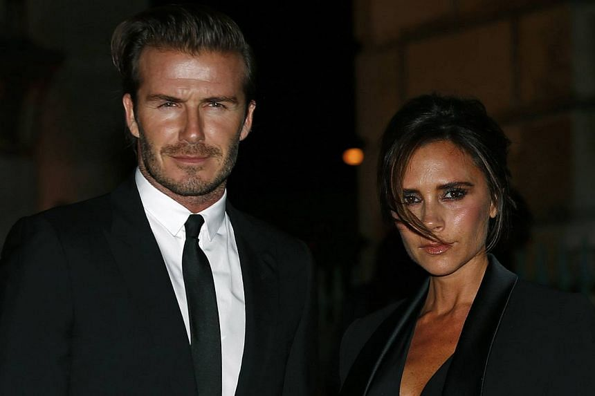 Former England soccer captain David Beckham and his wife Victoria Beckham arrive for a London Fashion Week event to celebrate the Global Fund in London on Sept 16, 2013. Former Manchester United manager Alex Ferguson said on Wednesday that Beckham, h