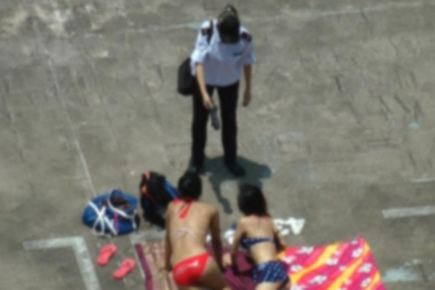 Two women dressed in their bikinis, who attempted to sunbathe at a Redhill multi-storey carpark on Wednesday, were scolded and chased away by a parking attendant, Chinese evening daily Lianhe Wanbao reported on Thursday. -- PHOTO: STOMP
