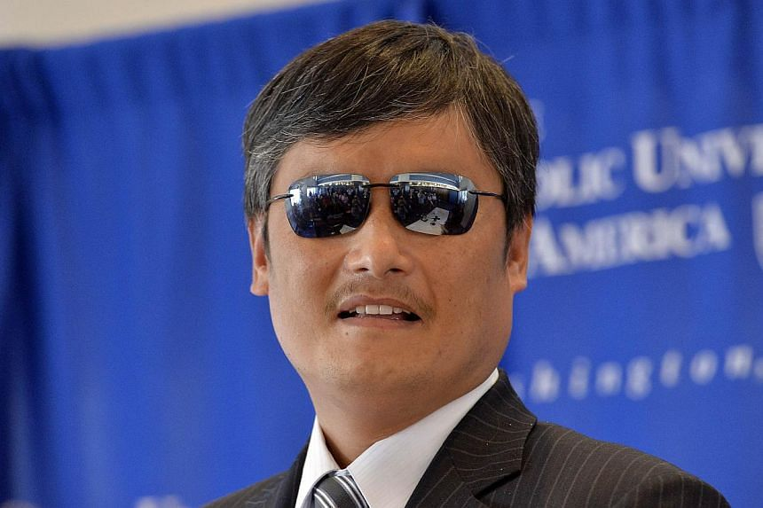 "Chen Guangcheng, the Chinese activist who dramatically escaped house arrest, said Wednesday he would speak out more boldly against Beijing's ""threat"" to humanity as he took positions at three US groups. -- PHOTO: AFP"