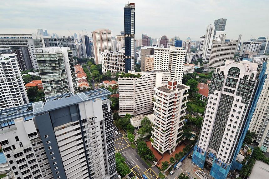 High-rise private apartment condominiums in the Scotts Road and Cairnhill area. Home prices could fall by as much as 20 per cent by the end of 2015 in the wake of oversupply, tougher loan rules and rising interest rates, say analysts. -- ST FILE PHOT