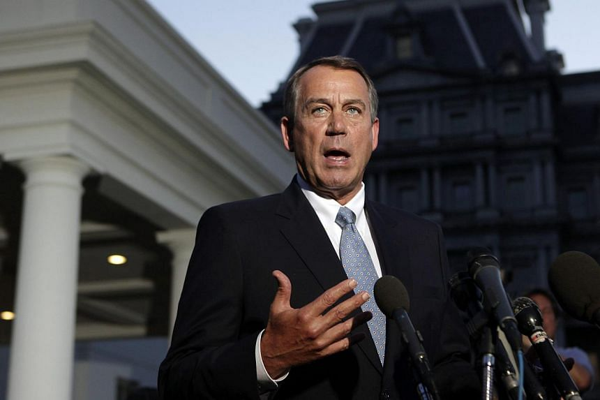 US House Speaker John Boehner speaks to the media following his meeting with US President Barack Obama, outside the West Wing of the White House in Washington, Oct 2, 2013. Republican House Speaker John Boehner left talks with US President Barack Oba