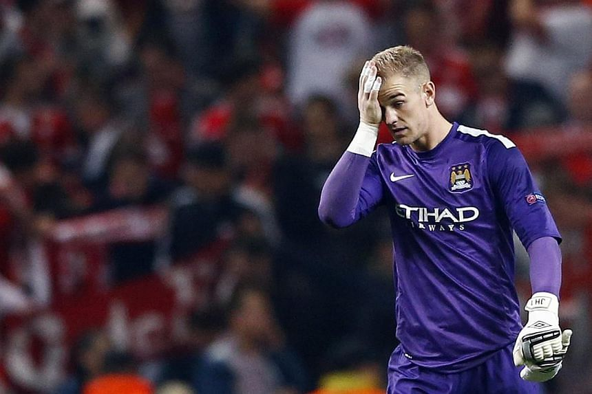 Manchester City goalkeeper Joe Hart reacts during their Champions League match against Bayern Munich at the Etihad Stadium on Oct 2, 2013.Hart remains England manager Roy Hodgson's number one goalkeeper despite mounting criticism of his form fo