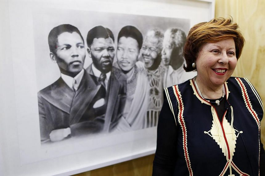 Curator Natalie Knight talks during the press view of her exhibition of art inspired by South Africa's former President and Nobel Peace laureate, Nelson Mandela, at the South African embassy in central London, Oct 2, 2013. -- PHOTO: REUTERS