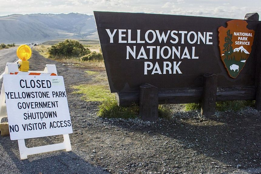 A sign announces the closure of the Yellowstone National Park in Wyoming Oct 2, 2013 in the wake of the government shutdown. US President Barack Obama scaled back a long-planned trip to Asia on Oct 2, 2013 and planned a meeting with Democratic and Re