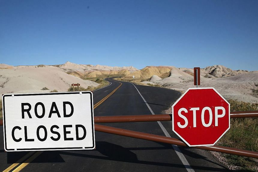 A barricade prevents visitors from entering the interior of the Badlands National Park on Oct 1, 2013 near Wall, South Dakota. All national parks were closed today after congress failed to pass a temporary funding bill, forcing about 800,000 federal