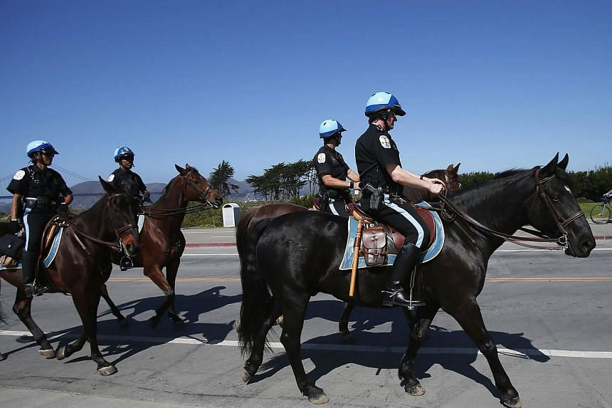 Members of the United States Park Police horse-mounted unit patrol in Crissy Field, which has been closed due to the federal government shutdown, in San Francisco, California Oct 2, 2013. Cancellations and delays caused by the federal government shut