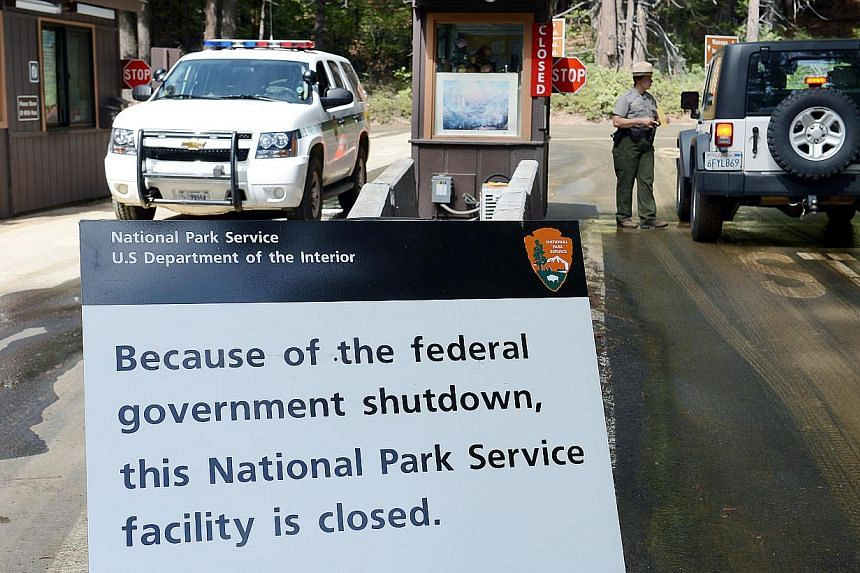 This Tuesday, Oct 1, 2013, photo shows a sign on Highway 41 north of Fresno, California, alerting motorists of the closure of Yosemite Park due to the government shutdown. President Barack Obama brought top lawmakers to the White House on Wednesday,