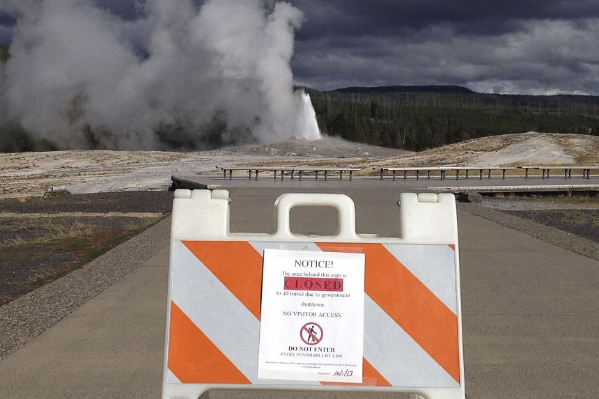 A sign announces the closure of the Old Faithful Geyser in Yellowstone National Park in Wyoming Oct 1, 2013 in the wake of the government shutdown. US President Barack Obama scaled back a long-planned trip to Asia on Oct 2, 2013 and planned a meeting