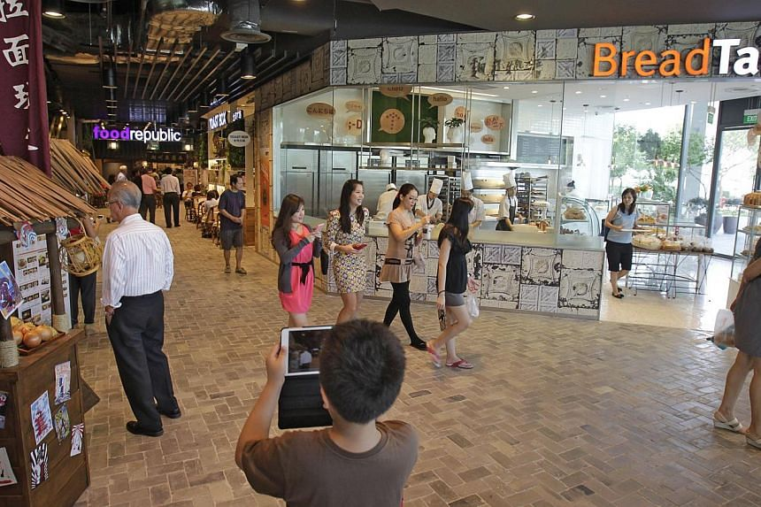 (From left) Ramen Play, Food Republic, Toast Box and BreadTalk on level one of BreadTalk's international headquarters building in Tai Seng. BreadTalk officially opened its $67 million international headquarters at Tai Seng Street on Oct 4, 2013. -- S