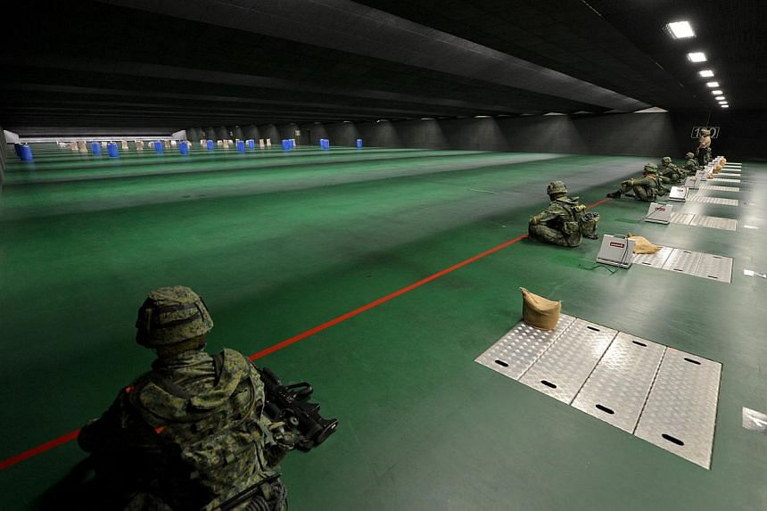 The 100m firing range at the new SAF Multi-Mission Range Complex (MMRC) located in Pasir Laba camp. Singapore's soldiers will now spend a lot more time sharpening their marksmanship at the Republic's latest indoor firing range that went fully-operati