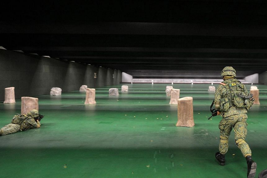 NSmen at a firing exercise in a 100m range at the new SAF Multi-Mission Range Complex (MMRC), which is a first of its kind three-storey indoor live firing range located at Pasir Laba. Singapore's soldiers will now spend a lot more time sharpening the