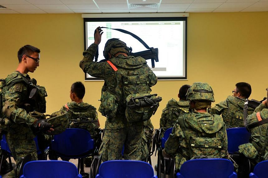 NSmen gather in an air-conditioned room where they are debriefed after a firing exercise. Singapore's soldiers will now spend a lot more time sharpening their marksmanship at the Republic's latest indoor firing range that went fully-operational on Fr