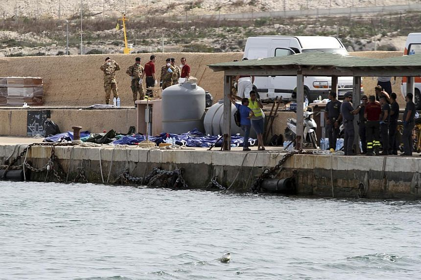 Bodies of drowned migrants are lined up in the port of Lampedusa on Oct 3, 2013. More than 300 people drowned or were feared dead after a boat packed with African migrants caught fire and sank off the southern Italian island of Lampedusa on Thursday,
