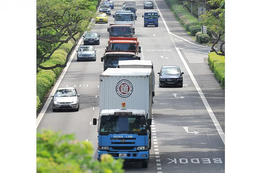 Sky-high certificate of entitlement (COE) prices for commercial vehicles have become a worry for businesses, motor traders and the authorities. -- ST FILE PHOTO: LIM YAOHUI