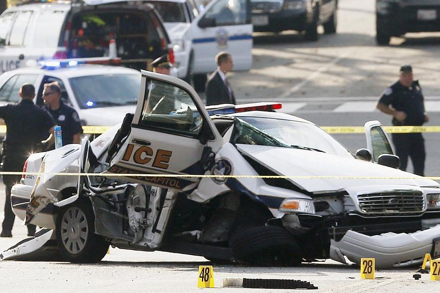 A wrecked Capitol Police car blocks Constitution Avenue NW following a shooting on Capitol Hill in Washington, on Oct 3, 2013. A dramatic car chase through the streets of Washington from near the White House to the United States Capitol ended in gunf