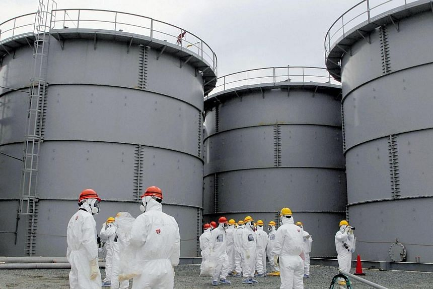 Tanks of radiation-contaminated water at the Tokyo Electric Power Co (Tepco)'s tsunami-crippled Fukushima nuclear power plant in Fukushima prefecture on March 1, 2013. Japan's atomic watchdog summoned the boss of Tepco for a public dressing-down over