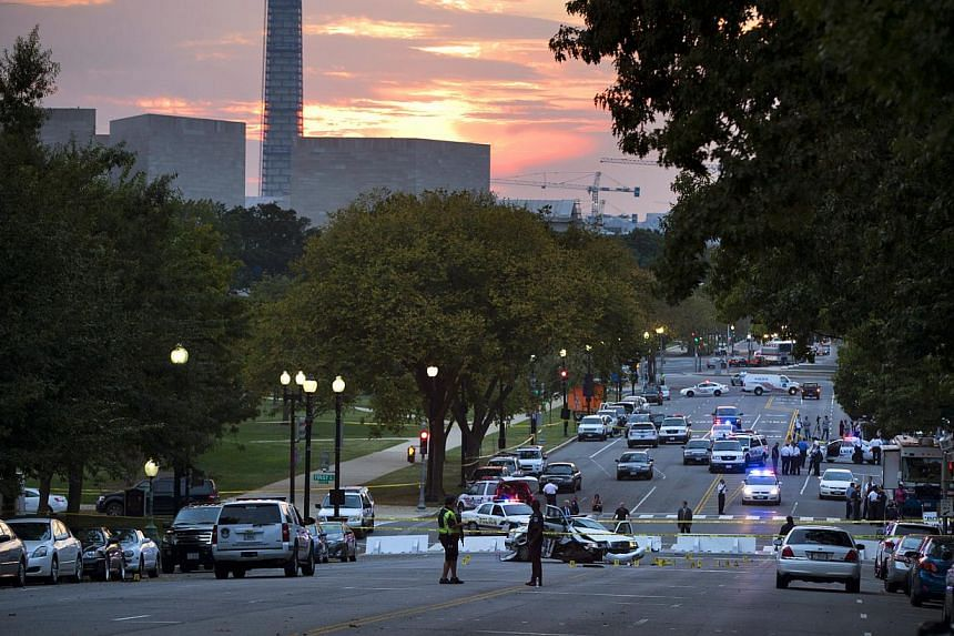A damaged Capitol Hill police car is surrounded by crime scene tape on Constitution Avenue near the United States (US) Capitol after a car chase and shooting occurred on Oct 3, 2013, in Washington. A dramatic car chase through the streets of Washingt