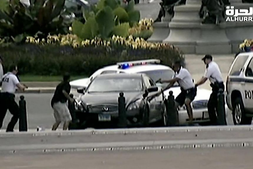 People taking cover (above) as gun shots rang out at the US Capitol on Thursday. Police (left) surrounding the black car that rammed a security barricade.