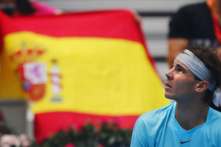 Rafael Nadal (above) of Spain takes a break during his men's singles semi-final match against Tomas Berdych of the Czech Republic at the China Open tennis tournament in Beijing on Oct 5, 2013. Nadal said on Saturday that his greatest achievement