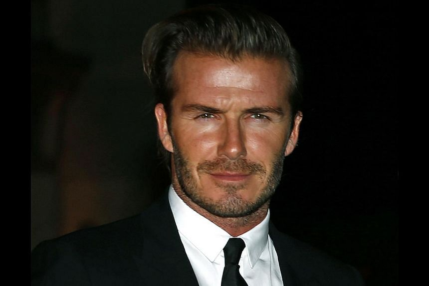 Former England soccer captain David Beckham arrives for a London Fashion Week event to celebrate the Global Fund in London on Sept 16, 2013. Beckham said on Oct 4 that England would make it through to next year's World Cup finals in Brazil as they pr