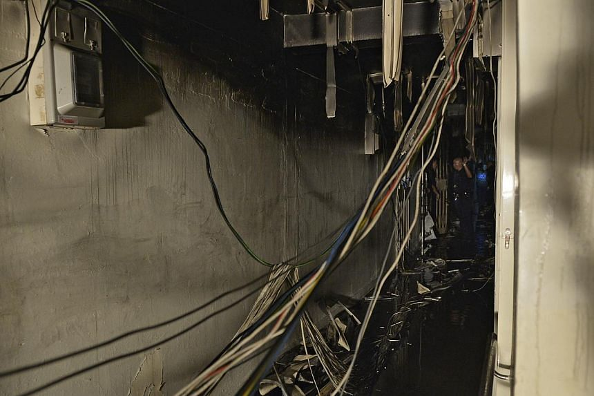 General view of the corridor where a fire at a flat in Owen Road left an elderly lady dead. A key witness in the fire incident - Madam Lakshmi's maid known only as Rani - has been asked by the police to undergo a polygraph lie detector test. -- ST FI
