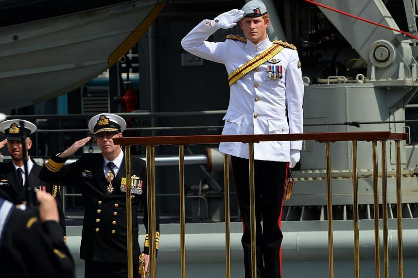 Britain's Prince Harry salutes at Garden Island in Sydney as he arrives to attend the 2013 International Fleet Review on Oct 5, 2013. -- PHOTO: AP