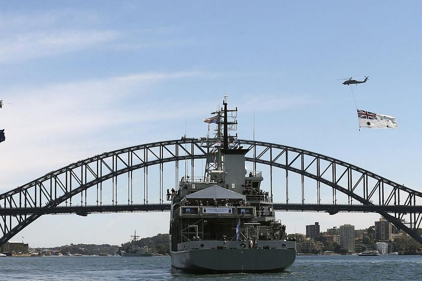 HMAS Leeuwin with Australia's Governor-General Quentin Bryce and Britain's Prince Harry, sites in front of the Harbour Bridge in Sydney, Australia, on Oct 5, 2013 during the International Fleet review. -- PHOTO: AP